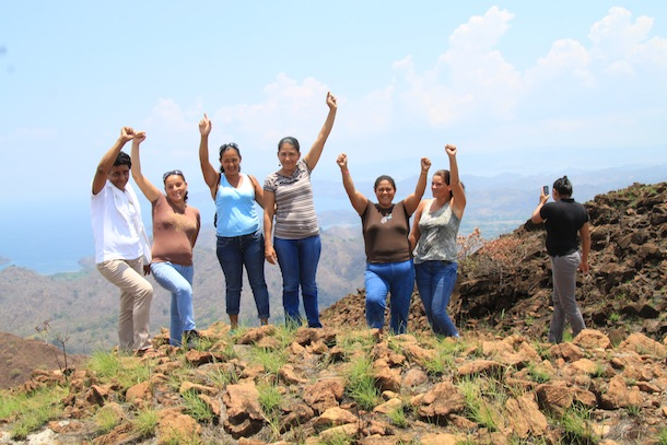The mothers of the children in the program reach the top of the high remote Cerro Ingles and celebrate, with the view all around