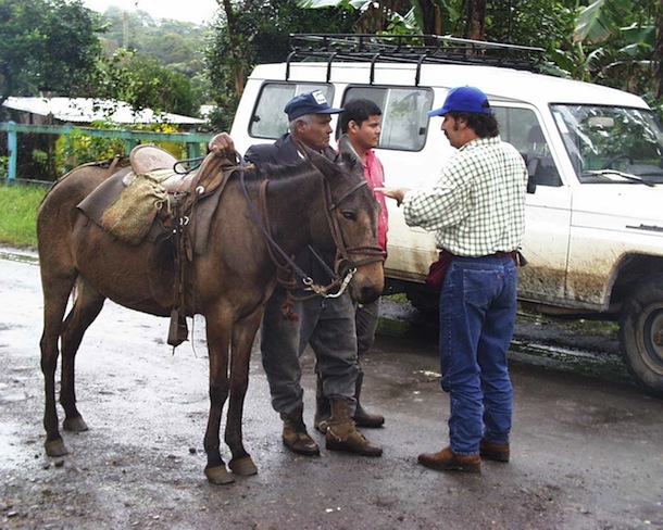 Sigifredo Marin in roadside land negotiations with landowner, his son, and his mule