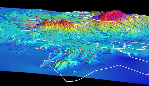 Contour map of region around the ACG, with legal boundaries of ACG outlined in white (including in the Pacific Ocean). Can see the flat lowlands, river courses, and the volcanos protruding upward in apparent 3-D.